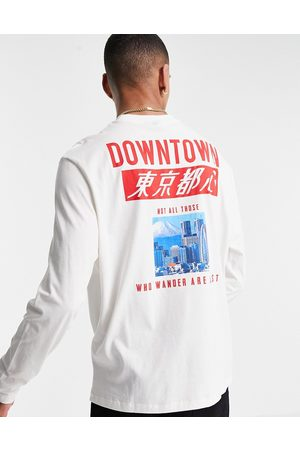 ASOS DESIGN Relaxed long sleeve t-shirt in off-white organic cotton with back city print