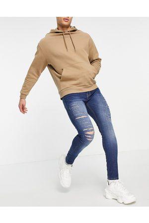 Criminal Damage Slim fit camden jeans in mid wash