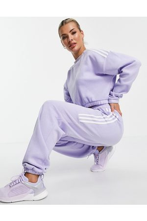 adidas performance Adidas Training oversized trackies with three stripes in lilac-Purple