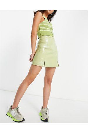 Muubaa Women Mini Skirts - Slit front leather mini skirt in patent green