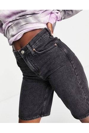 Topshop Longline denim shorts in wash black
