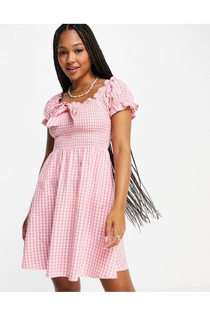 Influence Off the shoulder mini dress in pink gingham