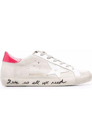 Golden Goose Women Sneakers - Superstar distressed sneakers