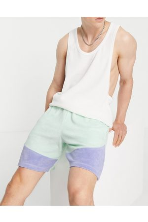 ASOS DESIGN Co-ord oversized towelling colour- block shorts in blue-Green