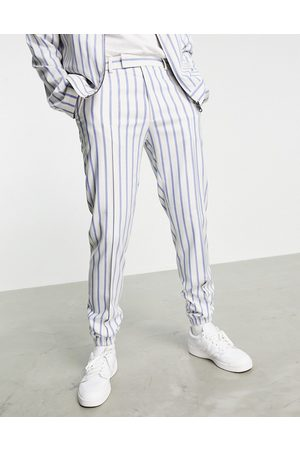 ASOS DESIGN Co-ord slim smart trackies in and blue stripe