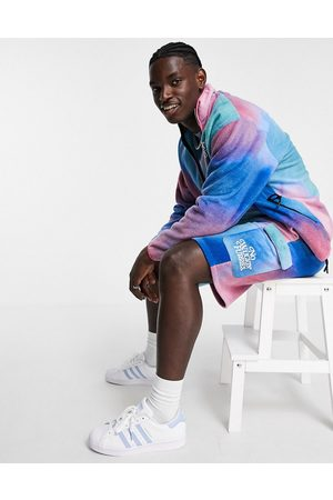 ASOS DESIGN Co-ord oversized polar fleece shorts in abstract print with embroidery