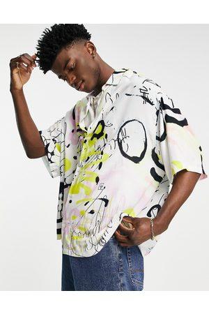 ASOS Boxy oversized grafitti print shirt in