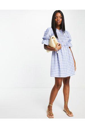 River Island Checked shirred mini dress in