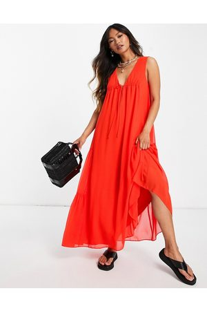 ASOS DESIGN Sleeveless trapeze maxi dress with tie detail and side tiers-Orange