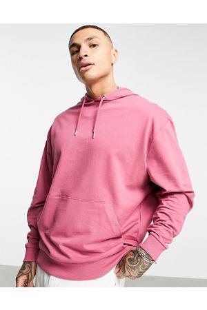 ASOS Organic lightweight oversized hoodie in pink