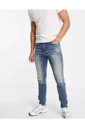 G-Star Skinny fit distressed jeans in mid wash
