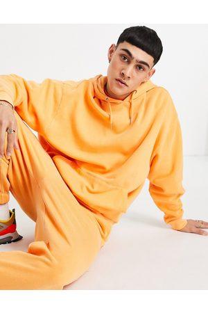 ASOS Organic co-ord oversized hoodie in orange vintage wash