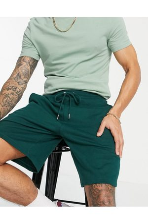 ASOS DESIGN Co-ord oversized jersey shorts in green