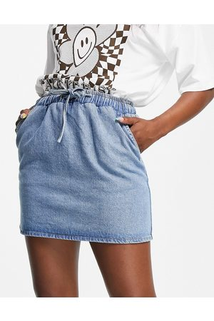 ASOS DESIGN Denim pull-on skirt in midwash