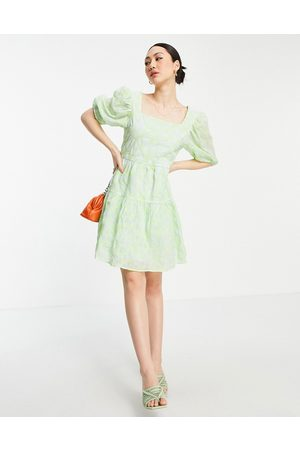 Vila Mini tulle smock dress with low back and bow detail in