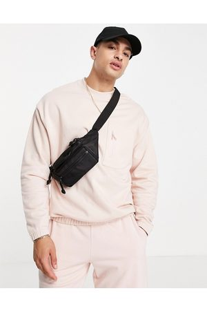 ASOS DESIGN Co-ord oversized sweatshirt with pocket detail in pink