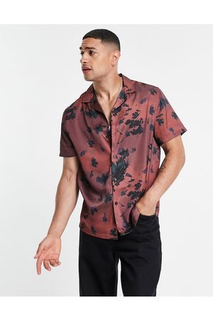 ASOS DESIGN Relaxed revere satin shirt in all-over floral print-Red