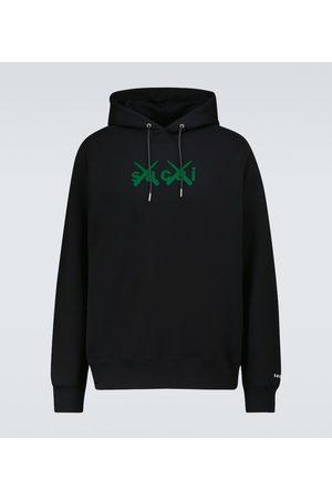 SACAI X KAWS Flock printed hooded sweatshirt