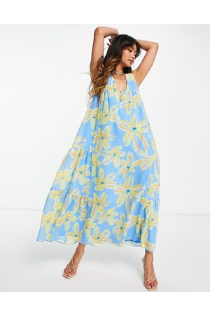 ASOS Sleeveless trapeze maxi dress with tie detail side tiers in 70s print-Multi