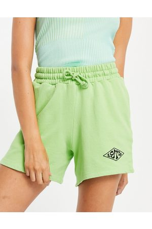 Topshop Co-ord trackie shorts with 1974 graphic in