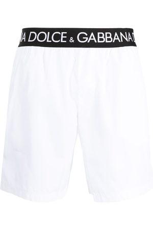 Dolce & Gabbana Logo-tape slip-on swim shorts