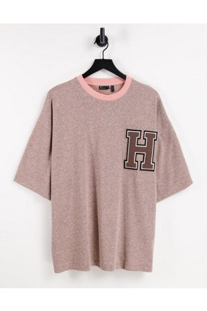ASOS DESIGN Oversized T-shirt in heavyweight pink marle with chest badge