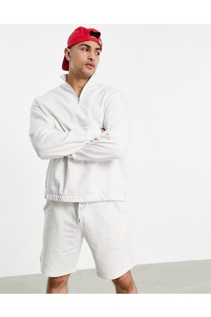 ASOS Tracksuit with oversized half-zip sweatshirt and oversized shorts in