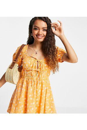 ASOS ASOS DESIGN Petite seersucker tie-front tiered beach mini dress in two-tone -Multi