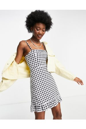 ASOS Women Summer Dresses - Strappy sundress with pep hem in black and white gingham