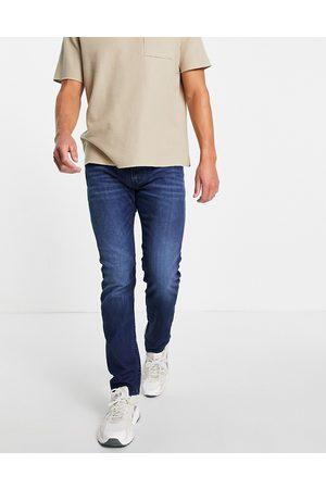 Diesel Men Slim - Thommer-x slim leg jeans in mid wash-Blue