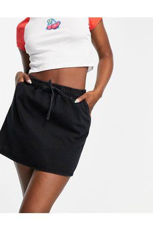 ASOS DESIGN Denim pull-on skirt in washed