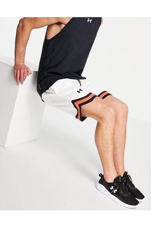 Under Armour Training Crest logo fleece shorts in