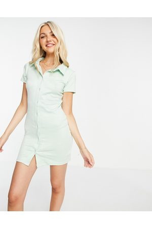 In The Style X Olivia Bowen button frill ribbed mini dress in -Green