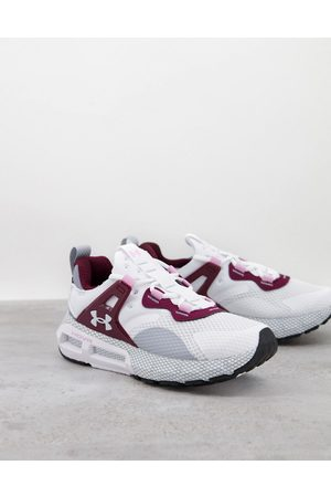 Under Armour Running HOVR Mega MVMNT trainers in and pink