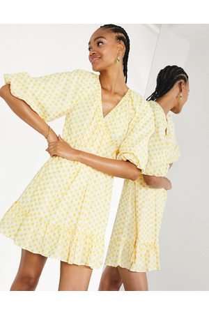 ASOS Embroidered daisy cotton wrap mini dress in ivory and yellow