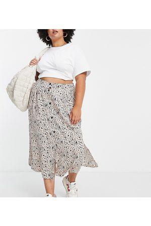 ASOS ASOS DESIGN Curve button through midi skirt with deep pocket detail in animal print