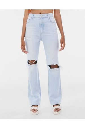 Bershka Flare jeans with knee rip in light
