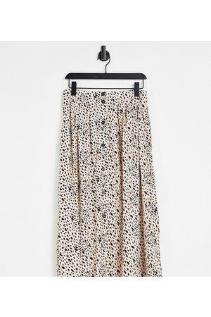 ASOS ASOS DESIGN Petite button-through midi skirt with deep pocket detail in animal print