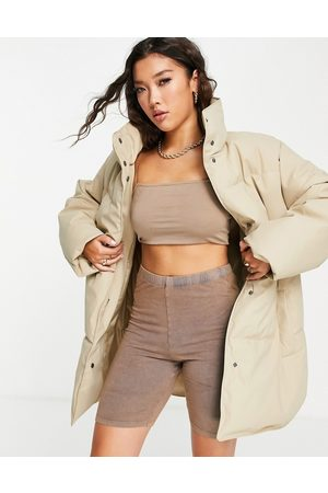 ASOS Rubberised oversized puffer jacket in -Neutral