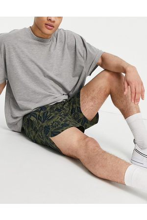 New Era Co-ord shorts in green with navy floral print