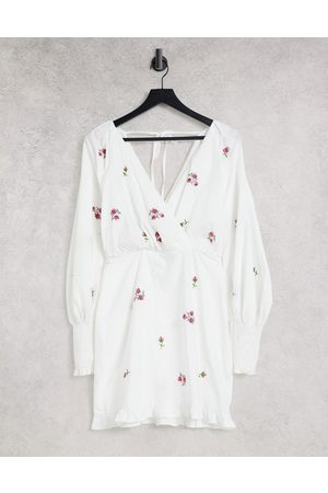 ASOS DESIGN Cotton poplin wrap front mini dress with all over embroidery in
