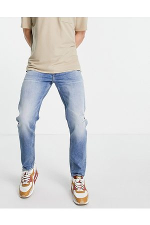 ASOS Stretch tapered jeans in vintage mid wash with rips-Blue
