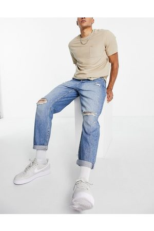 Topman Ripped relaxed jeans in mid wash