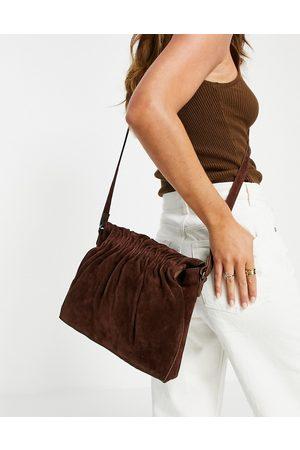 Urban Code Leather suede drawstring crossbody bag in
