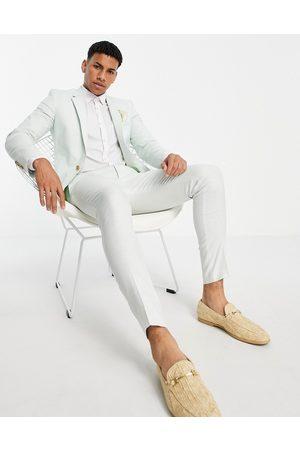 ASOS DESIGN Wedding super skinny suit pants in pastel green cotton linen