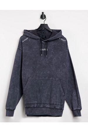 ASOS Oversized hoodie in black acid wash with Paris city prints