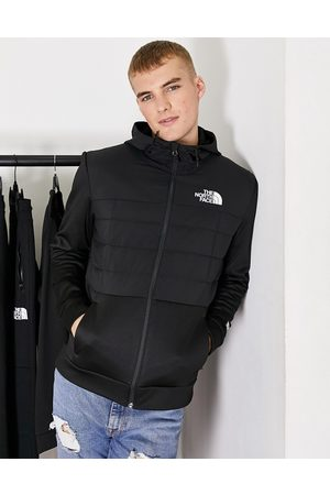 The North Face Mountain Athletic Hybrid insulated jacket in black