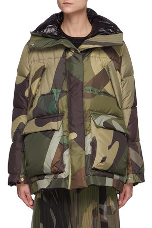 SACAI X KAWS Camouflage Print Puffer Jacket