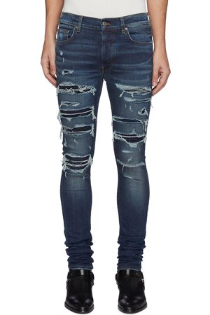 AMIRI Thrasher' Ripped Ribbed Panel Slim Fit Washed Biker Jeans