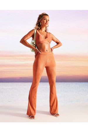 ASOS DESIGN Kick flare pants in animal jacquard with wrap tie waist in terracotta-Orange